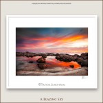 A fire red sky above the rocky coastline of the Leeuwin Natraliste National Park Western Australia