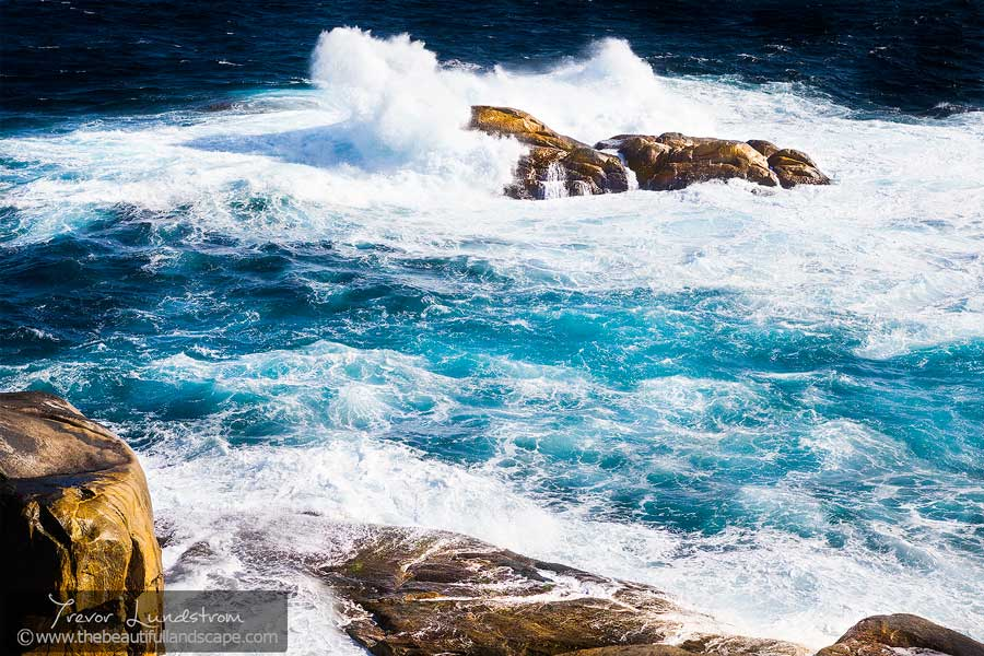 Giant swells rush into the rocky edge of southern Australia.